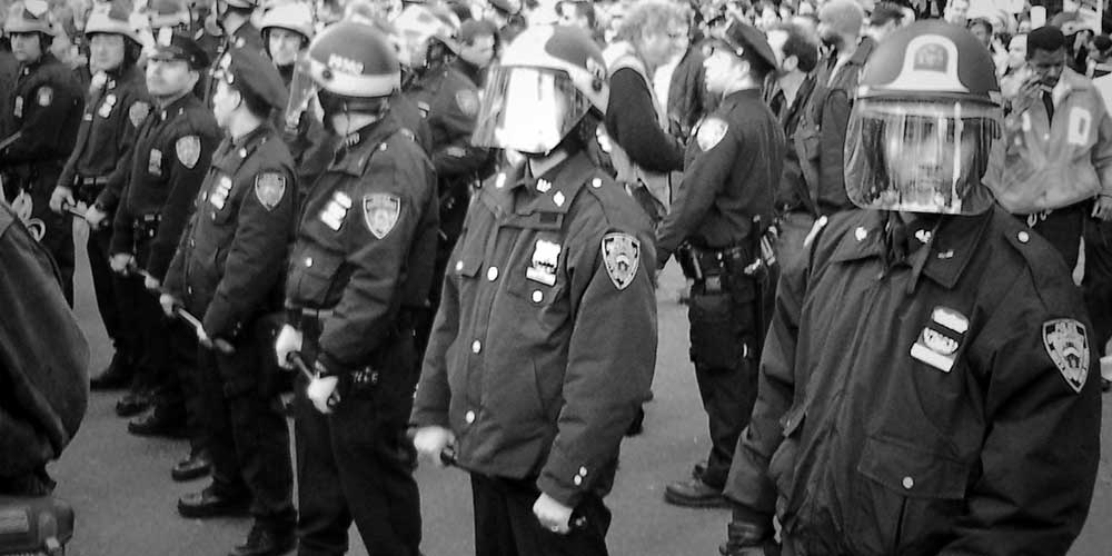 Line of police holding batons