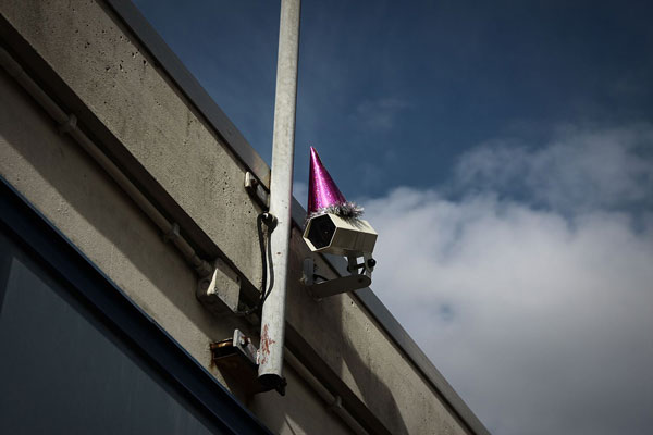 party-hats-on-surveillance-cameras