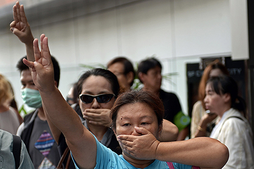 Three-finger salute in Thailand